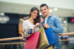 Happy couple with shopping bags. Portrait of happy couple with shopping bags Royalty Free Stock Photography