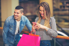 Happy couple with shopping bags. Portrait of happy couple with shopping bags Royalty Free Stock Image