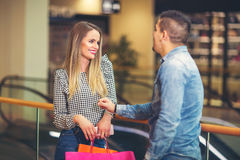 Happy couple with shopping bags. Portrait of happy couple with shopping bags Royalty Free Stock Images