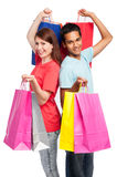 Happy Couple with Shopping Bags. Teenage couple with shopping bags. Studio shot on white background Royalty Free Stock Images