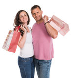 Happy couple with shopping bags. On a white background Stock Image