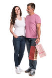 Happy couple with shopping bags. On a white background. Enjoying purchases Royalty Free Stock Photos