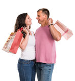 Happy couple with shopping bags. On a white background. Enjoying purchases Royalty Free Stock Images
