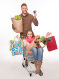 Happy couple with shopping cart Stock Photos