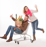 Happy couple with shopping cart Stock Image