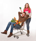 Happy couple with shopping cart Royalty Free Stock Photos