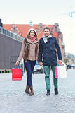 Happy couple shopping in the city Stock Photography