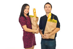 Happy couple with shopping food Stock Photos