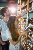Happy couple shopping for groceries Stock Images
