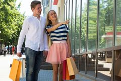 Happy couple on shopping. In city Stock Photos