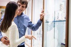 Happy couple shopping in jeweler shop Royalty Free Stock Image
