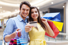 Happy couple in shopping mall Stock Photos