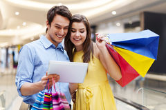 Happy couple in shopping mall Stock Image