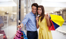 Happy couple in shopping mall Stock Photography