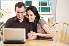 Happy couple shopping online Stock Image
