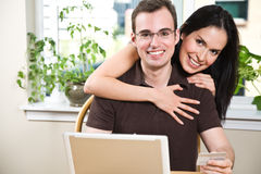 Happy couple shopping online Royalty Free Stock Photos