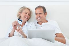 Happy Couple Shopping Online Stock Photo