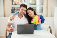 Happy couple shopping online on laptop Stock Photography