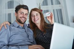 Happy couple shopping online present gifts Stock Image