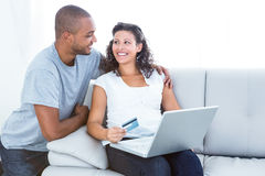 Happy couple shopping online Royalty Free Stock Image