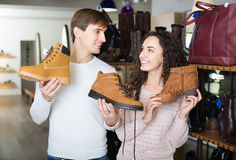 Happy couple shopping at shoe store Royalty Free Stock Photo