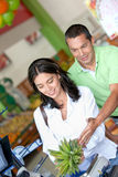 Happy couple shopping at the supermarket Royalty Free Stock Image