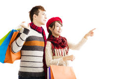 Happy couple shopping together with winter wear Stock Photos