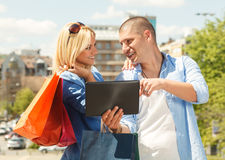 Happy couple in shopping Stock Photography