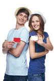 Happy couple showing credit cards Stock Photos