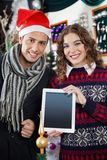 Happy Couple Showing Digital Tablet At Christmas Stock Photos