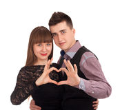 Happy couple showing heart with their fingers Royalty Free Stock Photography