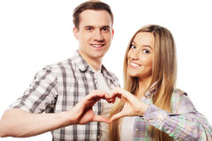Happy couple  showing heart with their fingers Royalty Free Stock Images