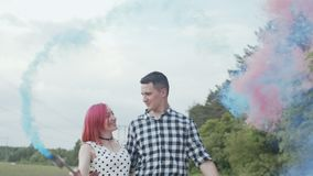 Happy couple showing smoke heart in countryside stock footage