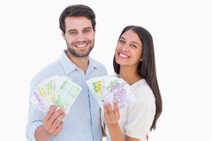 Happy couple showing their money Royalty Free Stock Photography
