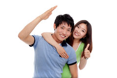 Happy couple showing thumbs. Royalty Free Stock Image