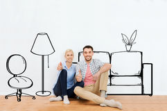 Happy couple showing thumbs up at new home Stock Photo