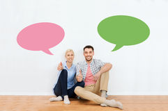 Happy couple showing thumbs up at new home Royalty Free Stock Images