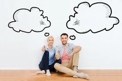 Happy couple showing thumbs up at new home Royalty Free Stock Photo
