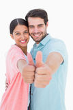 Happy couple showing thumbs up. On white background Royalty Free Stock Photography
