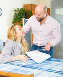 Happy couple signing papers Royalty Free Stock Image