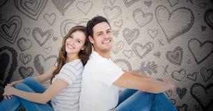 Happy couple sitting back to back Stock Images