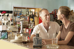 Happy Couple Sitting In Bar Stock Images