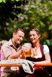 Happy Couple sitting in Beer garden Stock Image