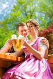 Happy Couple in Beer garden drinking beer Royalty Free Stock Photography
