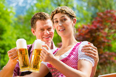 Happy Couple in Beer garden drinking beer Royalty Free Stock Image
