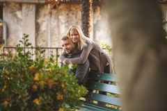 Happy couple sitting on a bench Stock Image