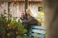 Happy couple sitting on a bench Royalty Free Stock Images