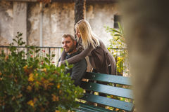 Happy couple sitting on a bench Stock Photography