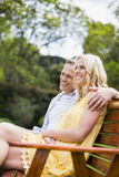 Happy couple sitting on a bench Stock Images