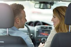 Couple sitting in a car Stock Photo